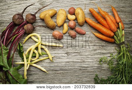 Fresh healthy mixed vegetables on wooden background