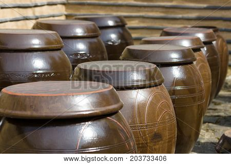 Ancient Korean traditional large earthen reservoir for food storage (Onggi). Background.
