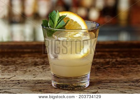 Classic American cocktail Southside based on gin lemon juice vodka syrup and mint