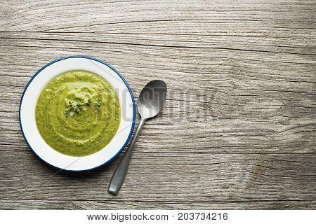 Fresh healthy vegetable green soup overhead shoot