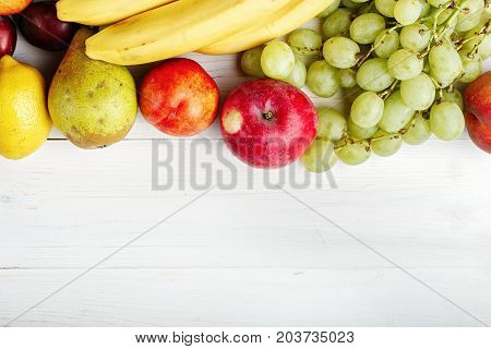 fruit background with exotic fruits on white background fruit detox space for text