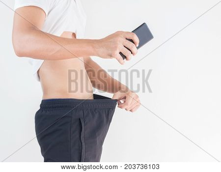 Young man looking with holding cell phone for selfie him crotch Healthy concept.