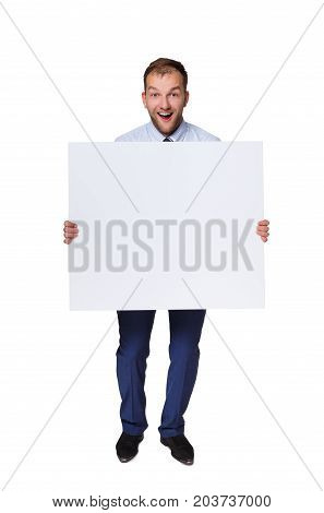 Happy young businessman showing blank signboard with copy space for text or slogan isolated on white background
