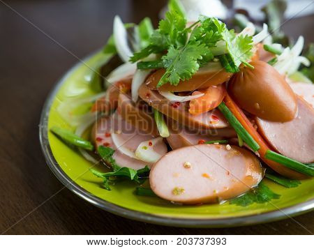 Sausage spicy salad with onion spring onion and coriander