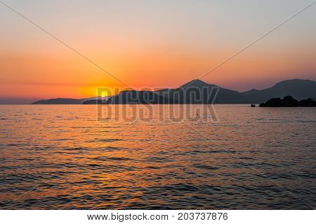 Tranquil nature scene of the ocean at sunset
