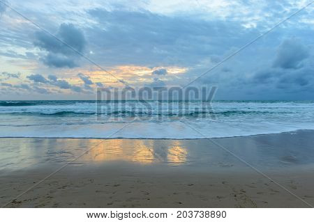 Dramatic sky and tropical beach at Surin beach Phuket island
