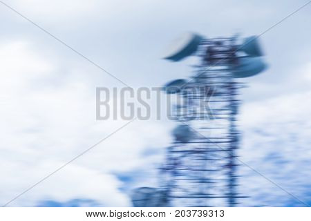 blurred telecommunication tower and cloudy sky good concept for bad signal or poor reception room for text or copy space