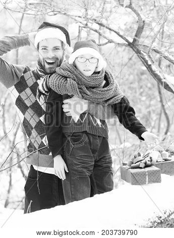 Christmas Boy And Man Father With Presents In Winter Outdoor