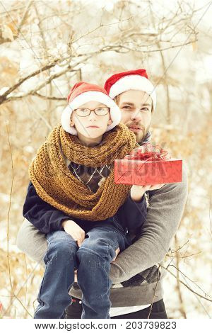 Christmas Boy And Man Father With Present In Winter Outdoor