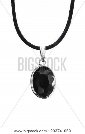Black crystal faceted medallion on black lace isolated over white