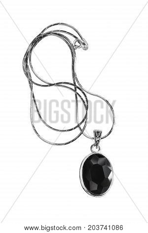 Vintage black faceted crystal medallion on silver chain isolated over white