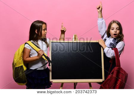 Kids Wearing Schoolbags Lean On Blackboard, Copy Space.