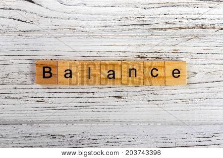 Balance word made with wooden blocks concept