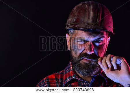 Guy With Brutal Image Wears Dirty Helmet And Plaid Shirt