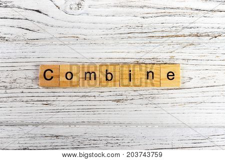 COMBINE word made with wooden blocks concept