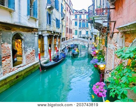 Venice, Italy - May 04, 2017: gondola sails down the channel in Venice, Italy on May 04, 2017. Gondola is a traditional transport in Venice, Italy