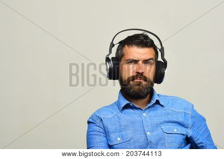 Guy With Beard And Concerned Face Listens To Music