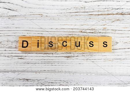 DISCUSS word made with wooden blocks concept