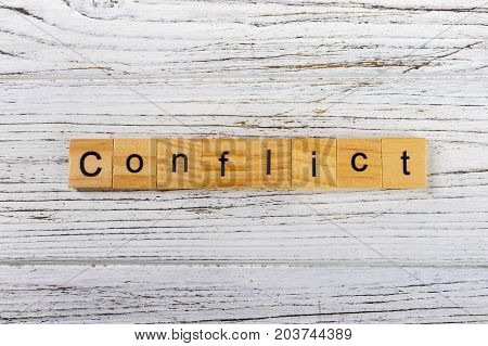 CONFLICT word made with wooden blocks concept