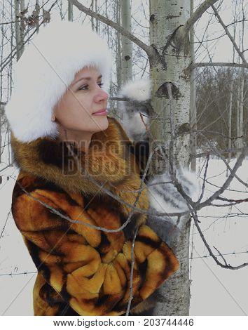 white forest winter woman snow young portrait cold fur beauty coat