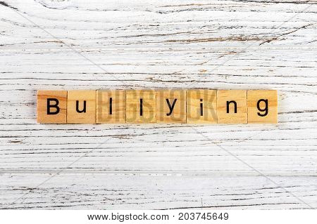 BULLYING word made with wooden blocks concept