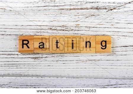 RATING word made with wooden blocks concept