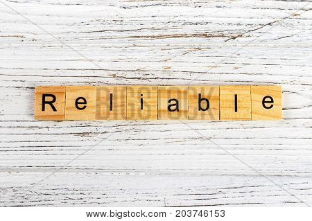RELIABLE word made with wooden blocks concept