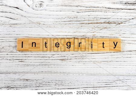 Integrity word made with wooden blocks concept
