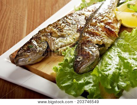 Two grilled Rainbow Trouts.Served with Vegetables , close up meal