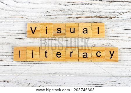 visual literacy word made with wooden blocks concept