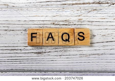 Faqs word made with wooden blocks concept