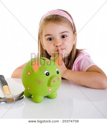 little girl thinking how to open piggy bank