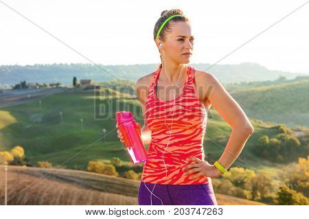 Healthy Woman With A Bottle Of Water Looking Aside