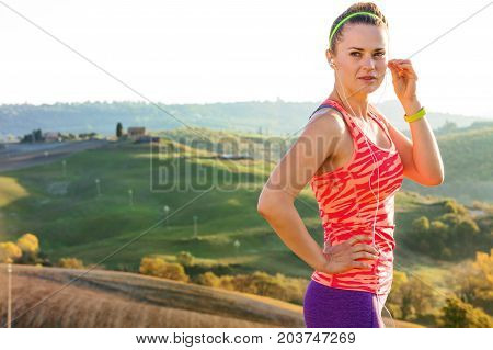 Fitness Woman With Headphones Listening To The Music