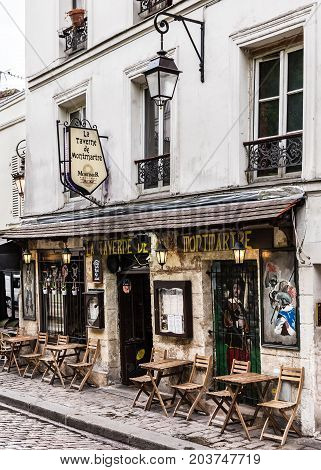 Paris France - July 06 2017: The charming cafe La Taverne de Montmartre on Montmartre hill. Montmartre with traditional french cafes and art galleries is one of the most visited landmarks in Paris.