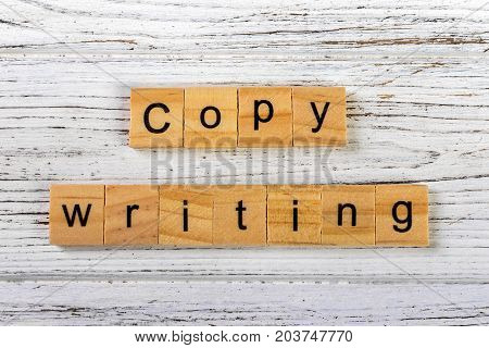copywriting word made with wooden blocks concept