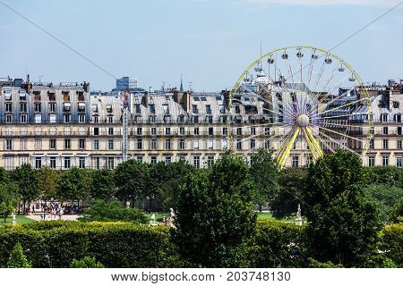 Paris France - July 05 2017: View of the Ferris wheel at the Tuileries Gardens (Jardin de Tuileries) on a summer sunny day.