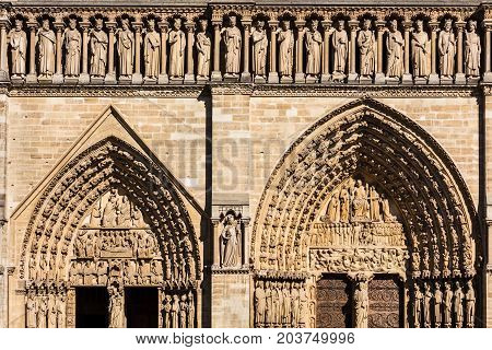 Architectural details of the catholic cathedral Notre Dame de Paris. Built in French Gothic architecture Notre-Dame's facade showing the Portal of the Virgin Portal of the Last Judgment and Gallery of Kings. Paris France