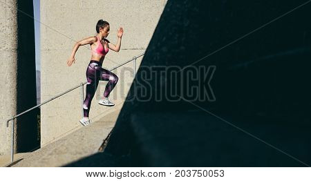 Fit Sportswoman Climbing Up The Steps