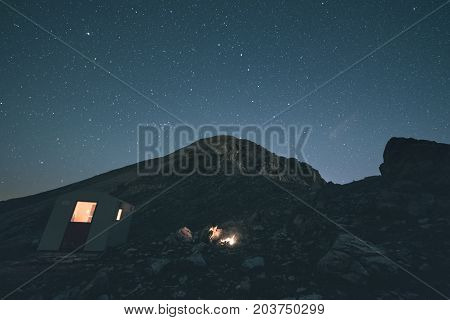 The Milky Way Over The Mountains, Long Exposure On The Italian-french Alps, Mountain Hut And Refuge