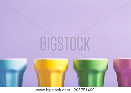 Little cups aligned on a bright background