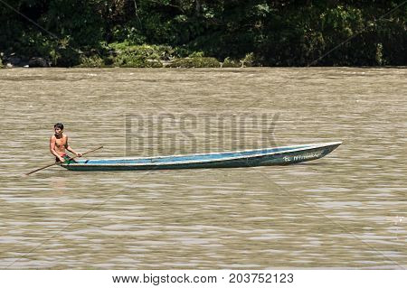 June 6 2017 Misahualli Ecuador: indigenous man in canoe on the Napo river in the Amazon area