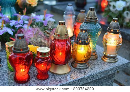 Lighting candles on the grave. All the Saints Day holiday on 1 November in Poland