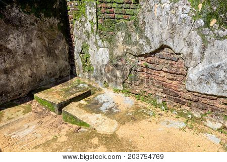 Interior view of Royal Palace of King Parakramabahu the Great in the world heritage city Polonnaruwa, Sri Lanka. Toilet or water closet