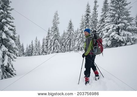 Smiling Traveler Is Standing In A Deep Snow
