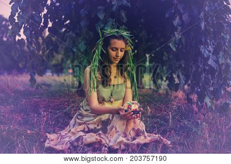 Forest Fairy Holds Lamp With A Candle