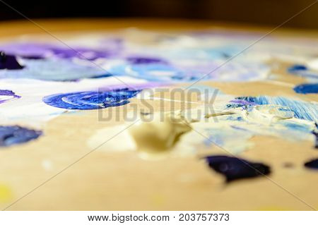 Artist Painting With Acrylic Colors And Mixing Tones