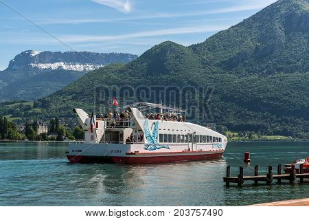 Annecy France - May 25 2016: Le Cygne catamaran trip boat on Annecy lake Haute-Savoie France.