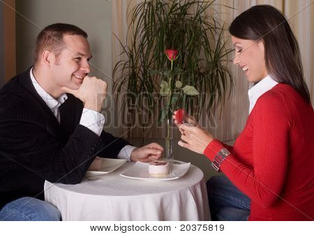 boyfriend is giving an engagement ring to his girlfriend on st Valentines Day