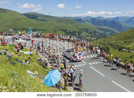 Col de PeyresourdeFrance- July 23 2014: Carrefour vehicles passing in the Publicity Caravn on the road to Col de Peyresourde in Pyrenees Mountains during the stage 17 of Le Tour de France 2014.